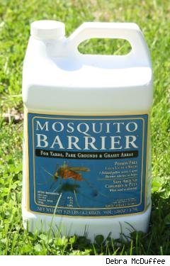 gallon jug of Mosquito Barrier on lawn