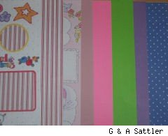 different patterns and colors of scrapbook paper