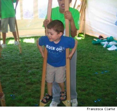 child learning to walk on stilts