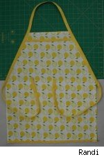 Photo of a apron made from a dish towel, with a lemon print