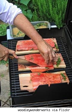 grill with salmon on cedar planks