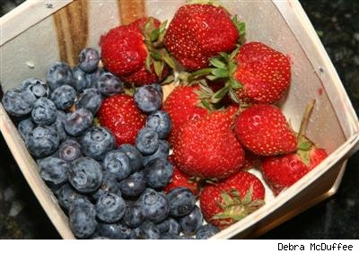 blueberries and strawberries in a berry basket
