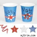 blue cups adorned with red gingham ribbon and sparkly stars