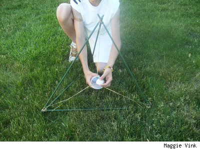 Boy loading a marshmallow in a catapult