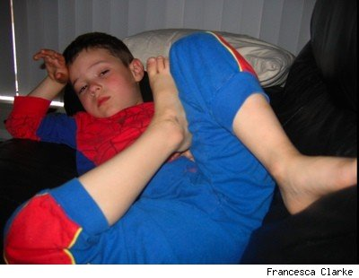 sick boy in spiderman pyjamas