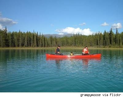 family canoeing on a lake