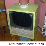 Vintage 1950s television converted to hold a kitty litter box.