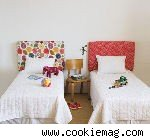 twin beds with fabric headboards