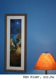 Blue wall with framed print and lampshade, source sxc.hu.
