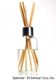 Reed diffuser with fragrance oil in a clear glass bottle with metal cap and reed straws, source sxc.hu