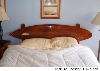 Bed with surfboard-shaped headboard in California hotel, image from Flickr.com.