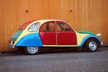 Car with brightly painted panels, Flickr.