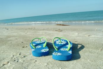 Blue flip flops on a beach, Flickr.
