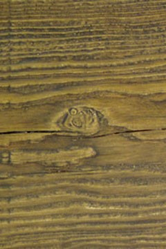 A closeup of the realistic grain of a faux wood beam. Photo: Faux Wood Beams