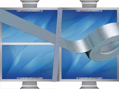 Four Apple 23-inch Cinema displays duct-taped together