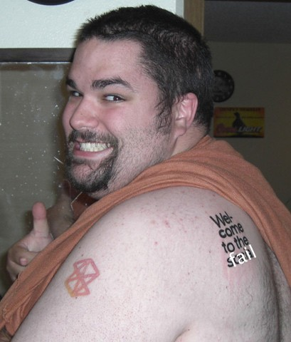 guy tattoo. his Zune tattoos with