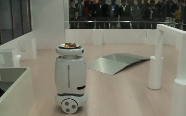 Toshiba's Wheelie robot carries your dinner, doesn't do burnouts