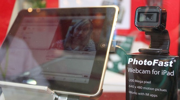 PhotoFast makes iPad work with a Microsoft webcam, cats and dogs  live together.