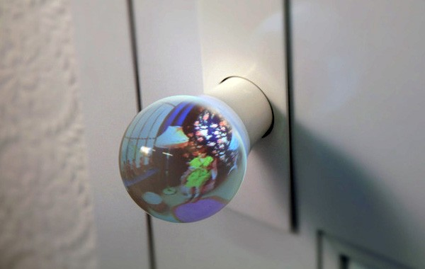 Glass globe doorknob gives you a view of what lies beyond for Glass globe doorknob