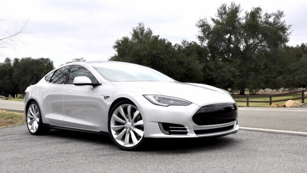 Silver Tesla Model S Alpha hits the road, carves some corners (video)