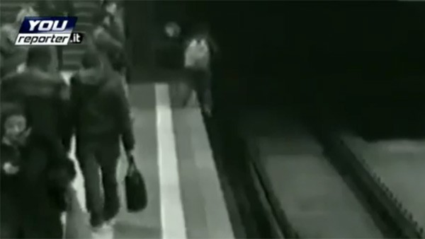 PSP-playing boy falls onto train tracks, saved by a real life hero (video)