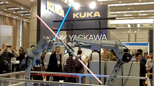Yasakawa robots perform lightsaber duel