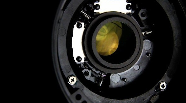 Canon 18-55mm lens torn open to expose visuals of Image Stabilization