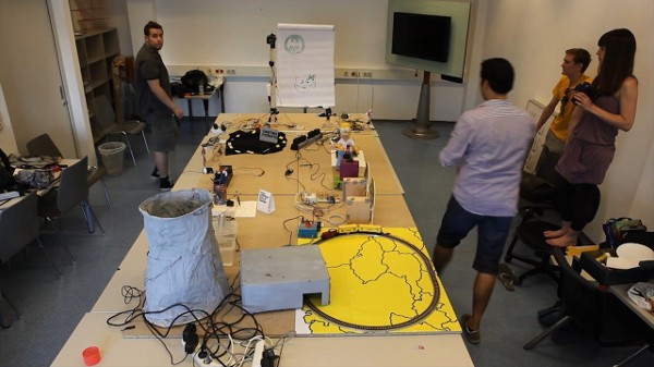 Pile of Arduinos hooked up in Rube Goldeberg-esque chain reaction (video)