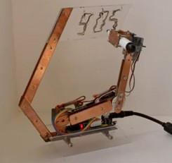 doodle clock Arduino powered Artbot writes the time, erases it, writes again (video)