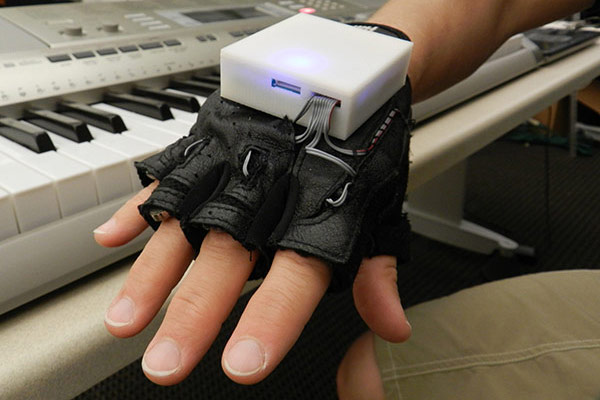 Vibrating glove gives piano lessons, helps rehab patients regain finger sensation, motor skills