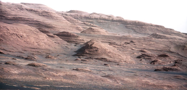 Voice signals sent to Mars and back, while telephoto images tease rich geology