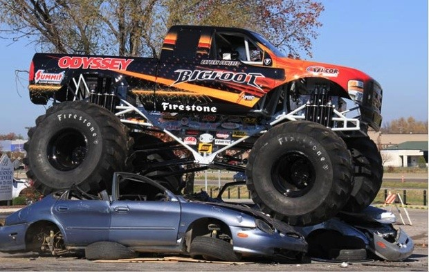Watch an allelectric Bigfoot monster truck crush cars quietly video