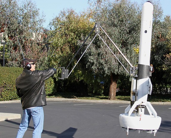 So this is how it ends DARPA demos a flying drone with a 6foot claw
