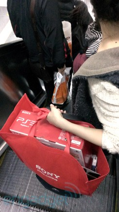 A girl brings a PS3 from Hong Kong into Shenzhen.