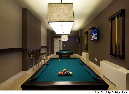 for those who cant afford to spend millions on a home some loft units in the building are selling for under 500000 billiard room lighting