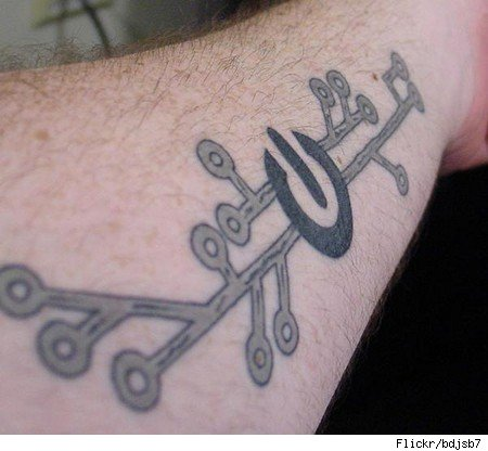 Tattoo combining computer power symbol with circuitry