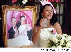 Thai bride with a portrait of herself.