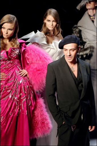 Current Dior designer John Galliano with models.