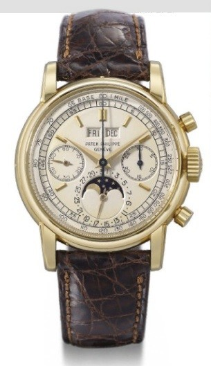 18K gold perpetual calendar chronograph.