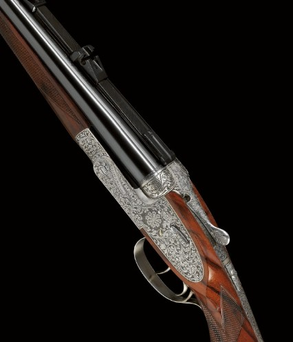 Double-barreled Purdey sporting rifle.
