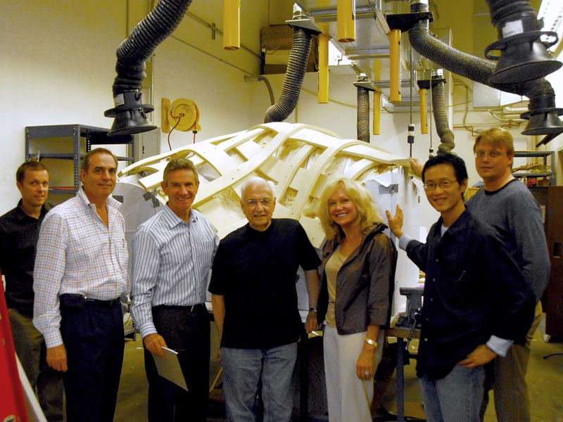 Gehry and his team with Kathryn Hall in front of the trellis mock-up.