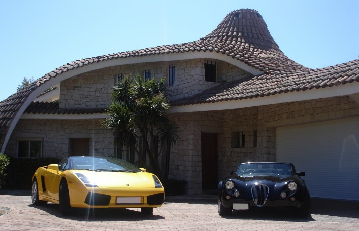The villa's Lamborghini and Wiesmann roadster