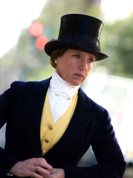 An equestrienne prepped for dressage.