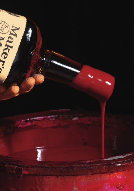 Hand-dipping the bottle's wax seal