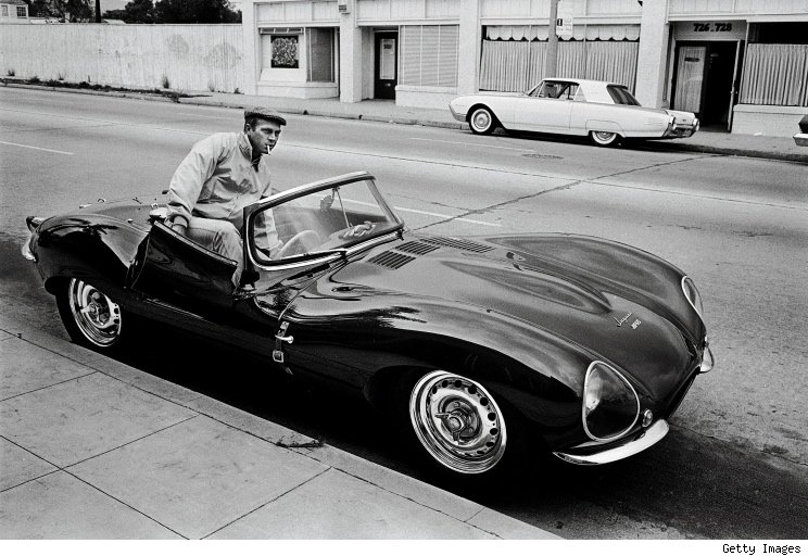 With his Jaguar XK-SS, 1963