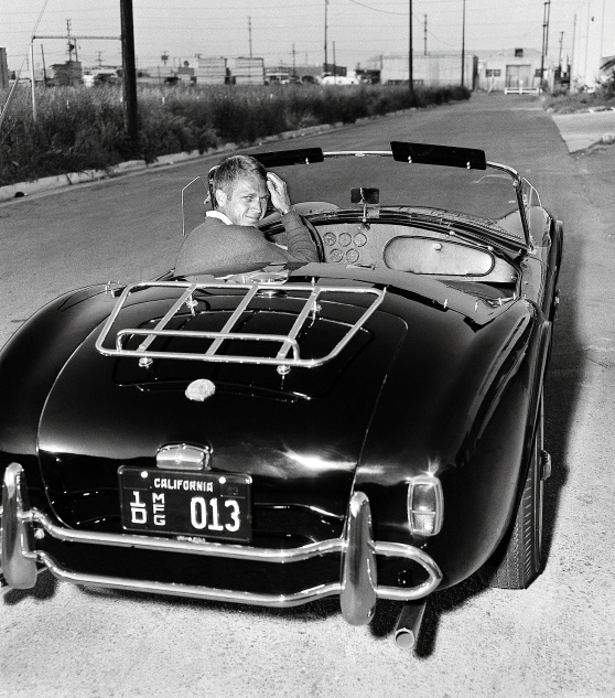 Driving his Ford AC Cobra, 1963