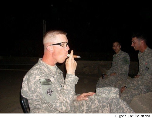A soldier smokes a Pepin Garcia in Iraq
