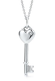 Heart key charm with a round brilliant diamond in sterling silver.