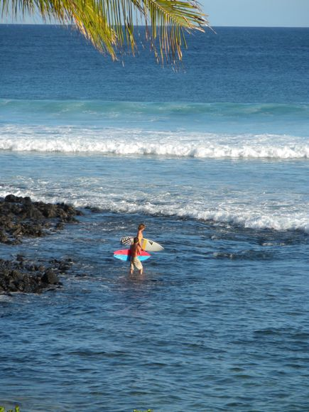 Surfers Head Out to Poipu Beach from Koa Kea
