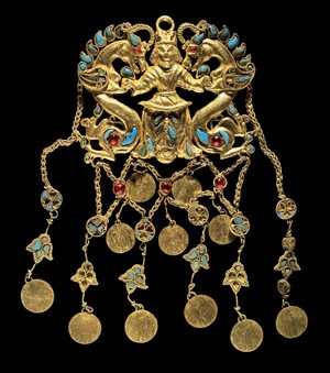 One of a pair of pendants depicting a